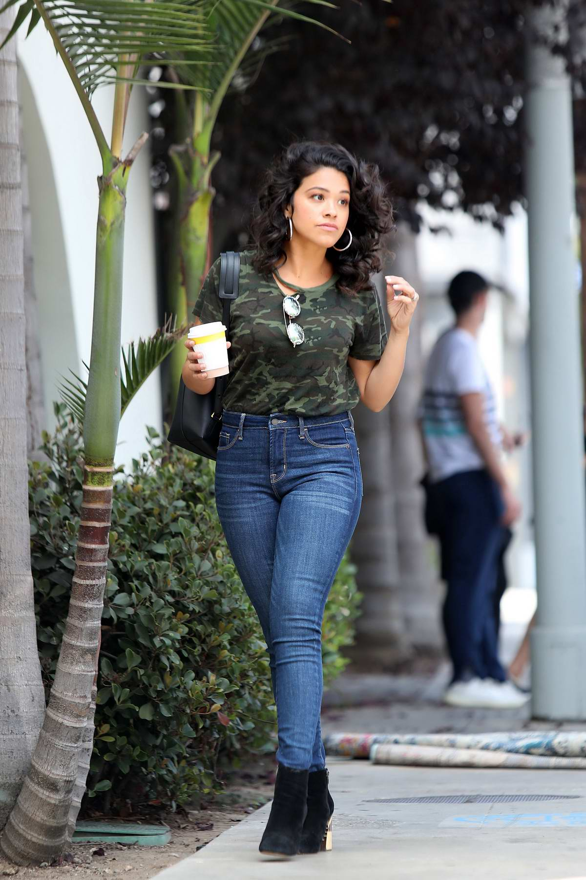 Gina Rodriguez Spotted In A Skinny Jeans And Camo Top