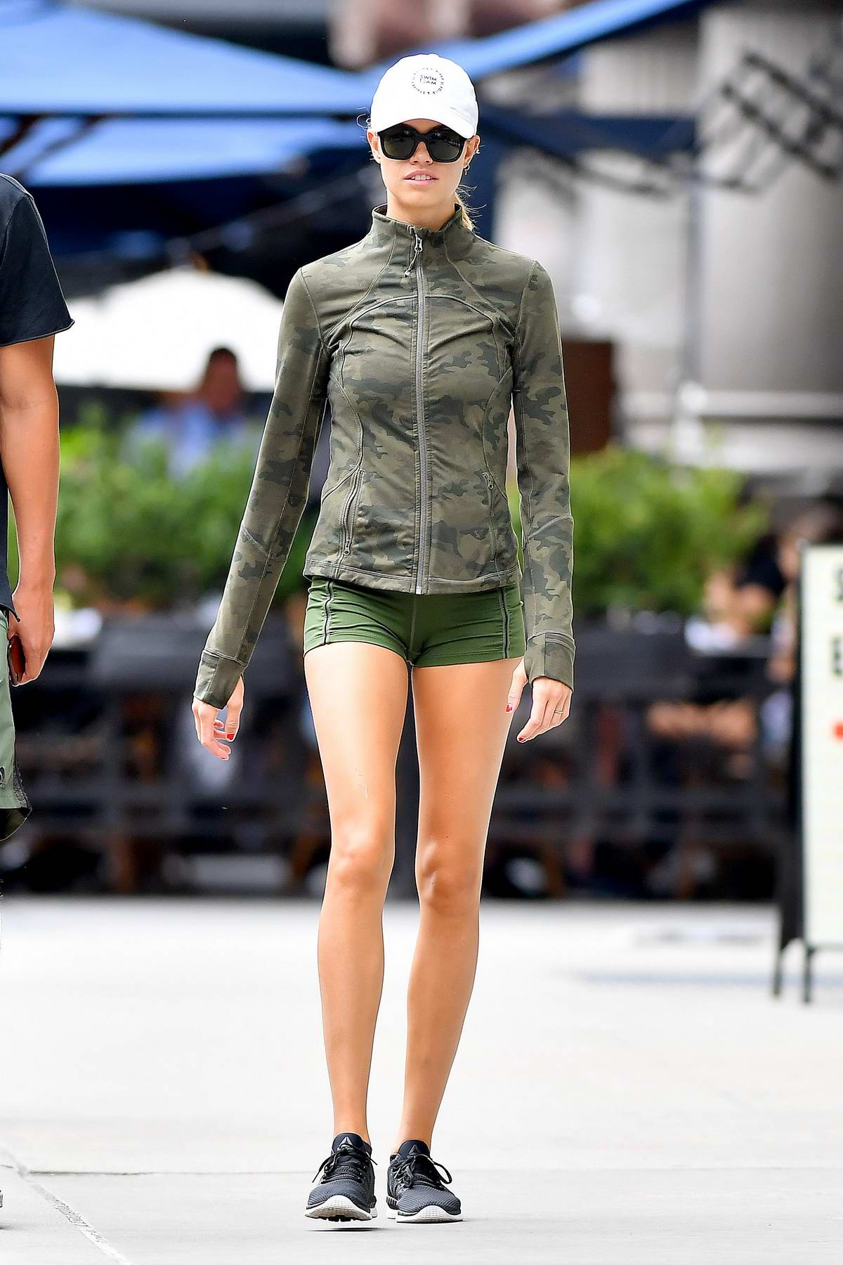 Hailey Clauson spotted in a camo jacket and short shorts while out with boyfriend Julien Harrera in New York City