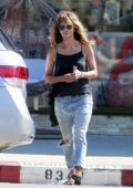 Halle Berry feeds the parking meter while out for shopping in West Hollywood, Los Angeles