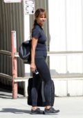 Halle Berry seen out with her friends wearing black top with matching black leggings and sneakers in Los Angeles
