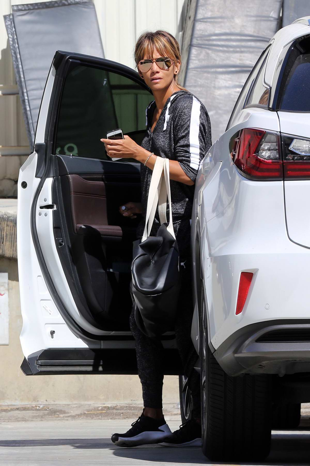 Halle Berry spotted in grey tracksuit and sneakers while out running errands in Los Angeles