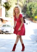 Hayden Panettiere is all smiles as she heads out in an all red ensemble in Los Angeles