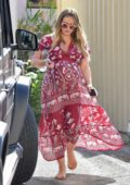 Hilary Duff looks lovely in a flowing red and white print dress while heading out in Studio City, Los Angeles