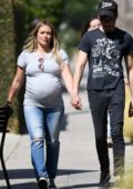 Hilary Duff wears a grey t-shirt and jeans while out for a stroll with boyfriend Matthew Koma in Los Angeles