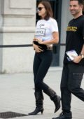 Irina Shayk wearing a Versace top and Fendi leggings as she arrives at the Versace Show during Milan Fashion Week in Milan, Italy