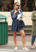 Irina Shayk wore a short denim dress and white sneakers while out for some shopping in New York City
