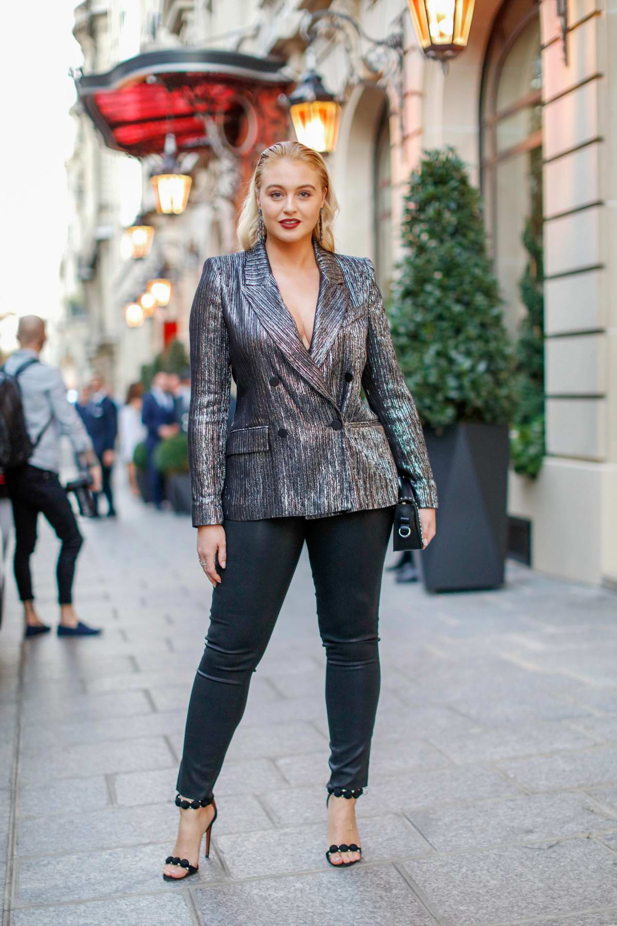 Iskra Lawrence steps out in striped grey blazer and black leather pants during Paris Fashion Week in Paris, France