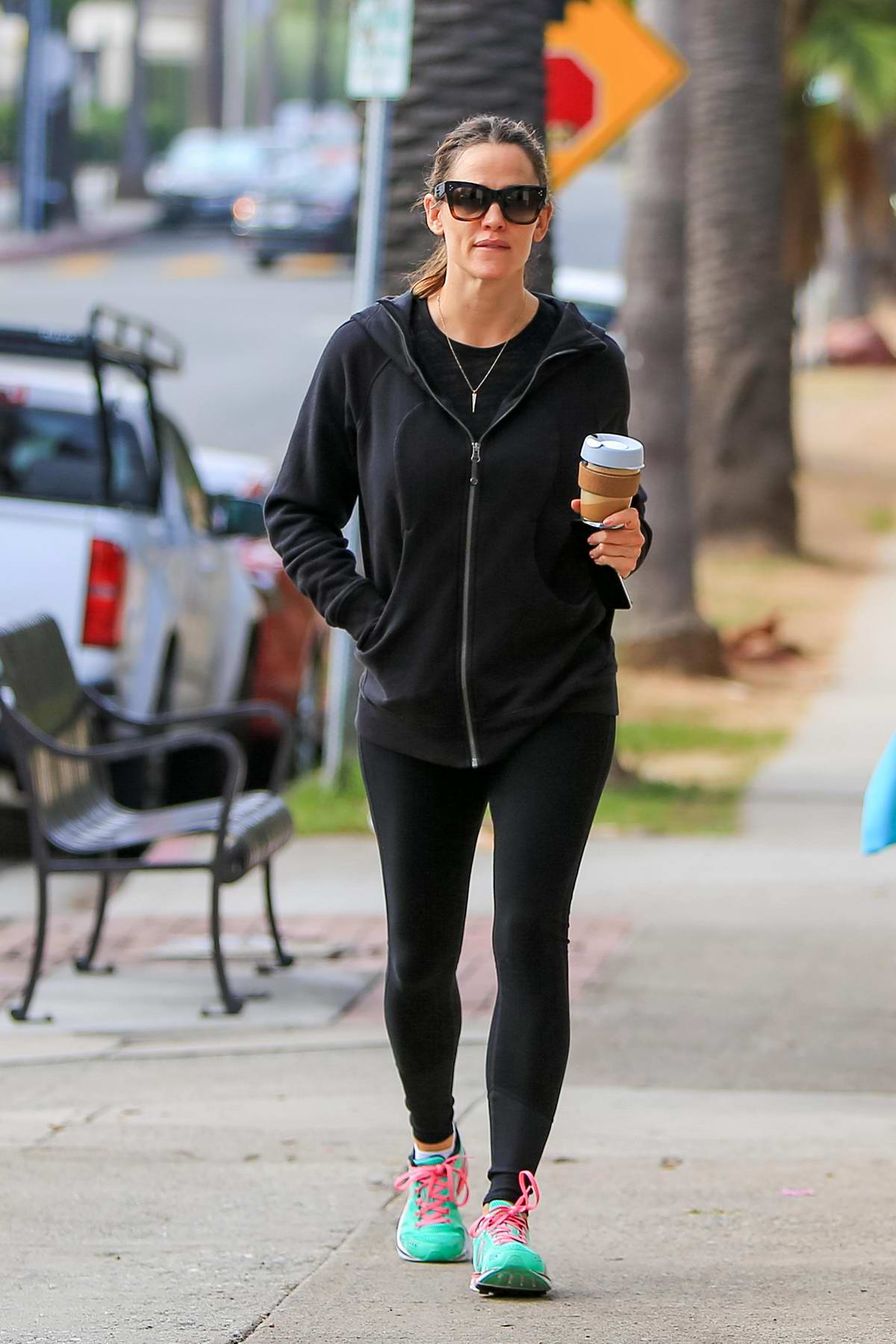 Jennifer Garner grabs her morning coffee while out for a morning walk with friend in Los Angeles