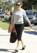 Jennifer Garner is all smiles as she leaves after Sunday church services in Pacific Palisades, California