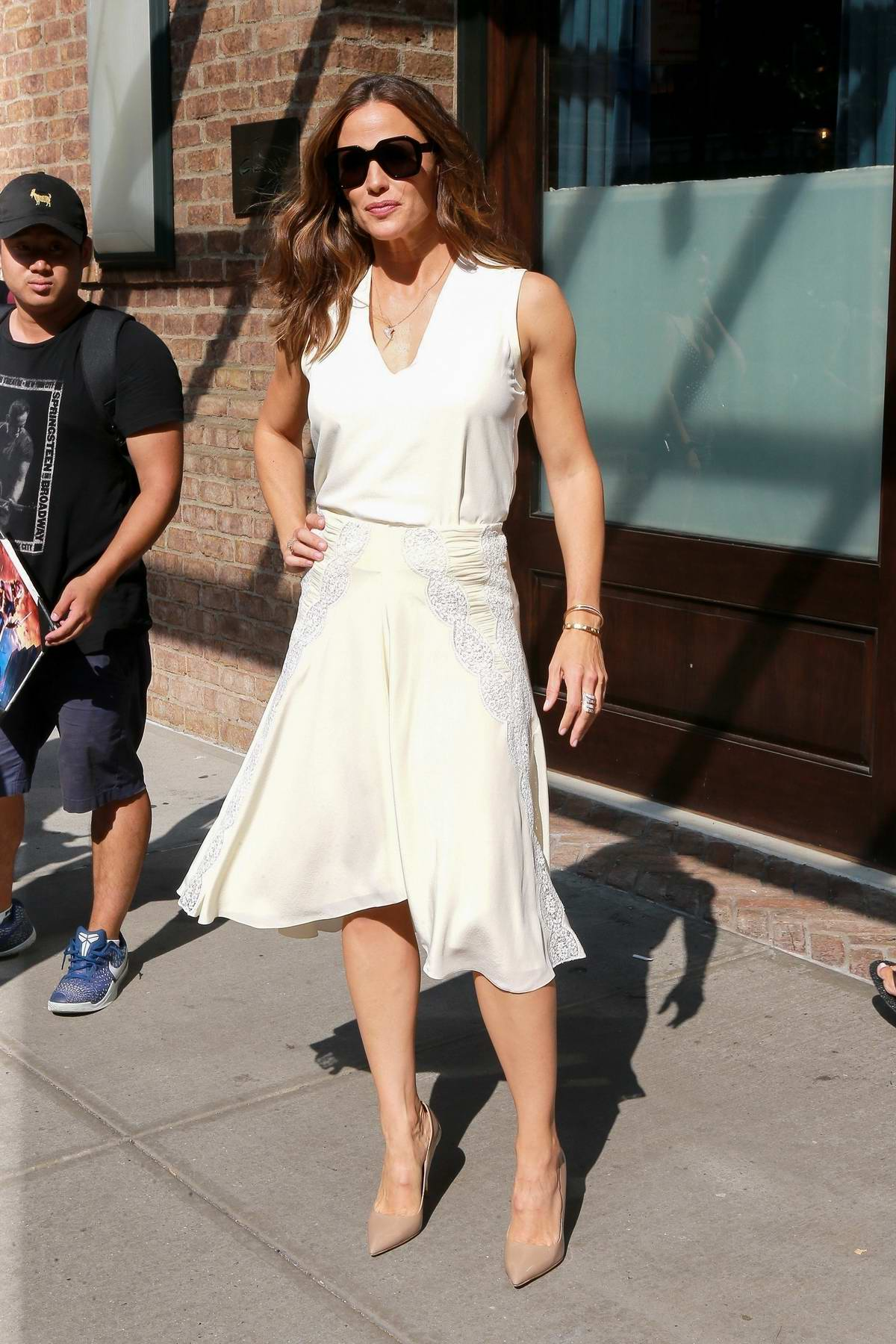 Jennifer Garner looks lovely in a white dress as she leaves The Greenwich Hotel to promote 'Peppermint' in New York City
