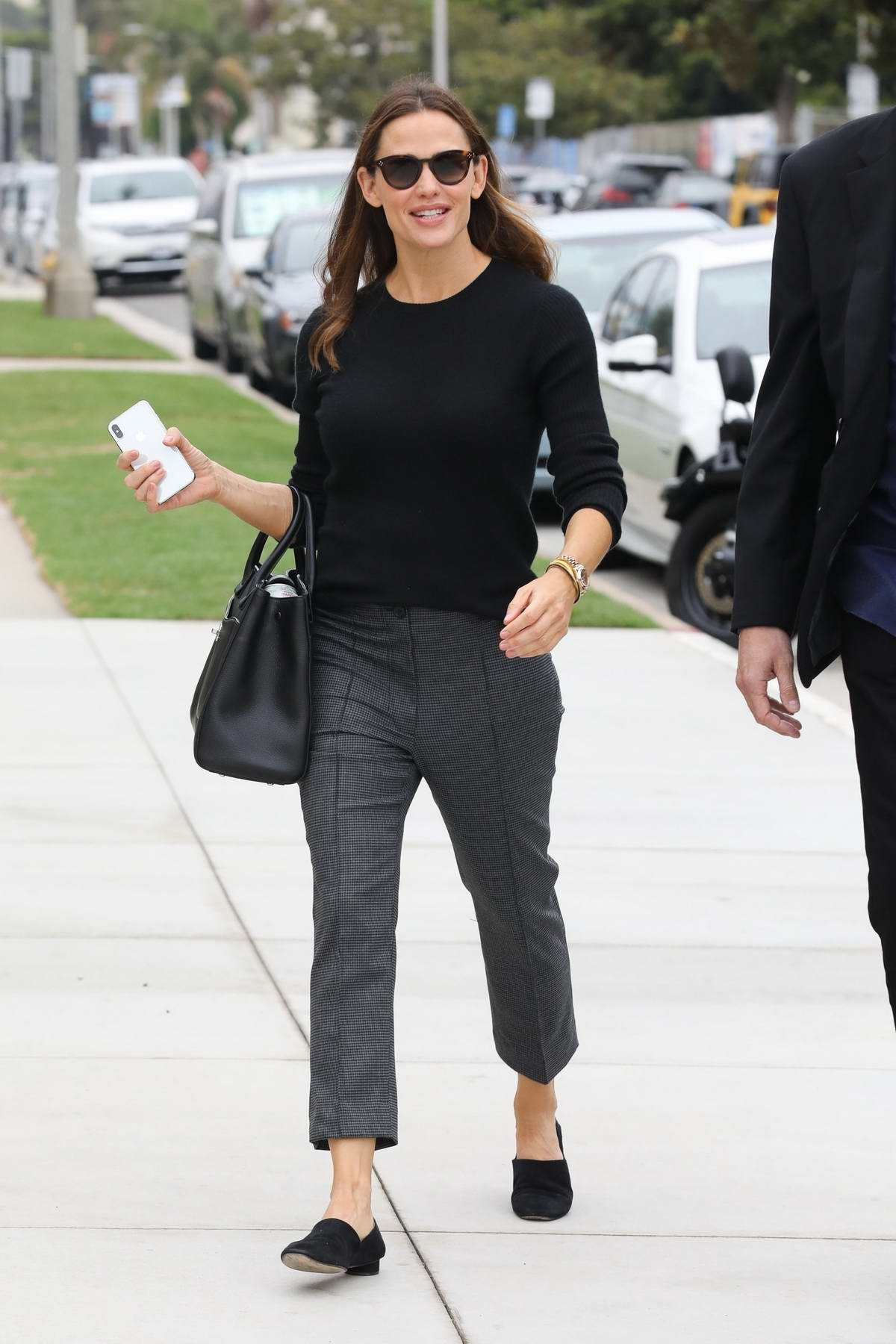Jennifer Garner looks lovely in black top and grey trousers as she attends church services in Pacific Palisades, California