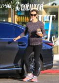 Jennifer Garner smiles for the camera as she leaves a salon in Brentwood, Los Angeles