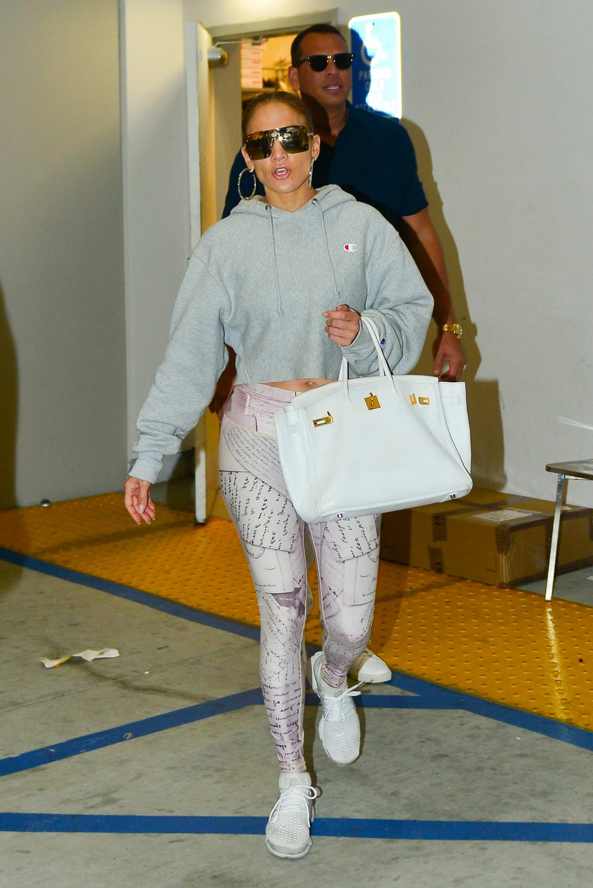 Jennifer Lopez sports cool sunglasses with a cropped grey hoodie and patterned leggings while out for shopping with Alex Rodriguez in Beverly Hills, Los Angeles