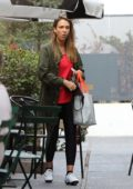 Jessica Alba hangs out with her class mates outside a spin class in Los Angeles