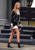 Josephine Skriver spotted in a black and white dress with black leather jacket during a photo shoot in New York City