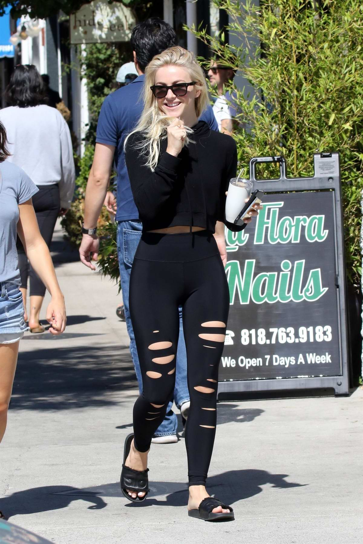 Julianne Hough steps out in a black crop top and ripped leggings while she grabbed her morning coffee at Joan's On Third in Studio City, Los Angeles