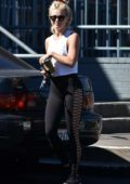 Julianne Hough waves to the camera as she leaves the gym in Los Angeles