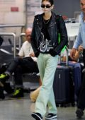 Kaia Gerber seen wearing a black leather jacket and jeans as she arrives at the airport in Milan, Italy