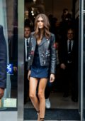 Kaia Gerber steps out in a black leather jacket over a blue dress during New York Fashion Week in New York City