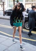 Kaia Gerber steps out wearing a black and green sweater with converse in Paris, France
