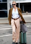 Karlie Kloss dons a formal look as she touches down at JFK airport in New York City