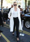 Karlie Kloss seen wearing in a white coat over a white shirt with black trousers while out during Paris Fashion Week in Paris, France