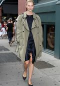 Karlie Kloss spotted in a trench coat over a blue silk dress while out in New York City