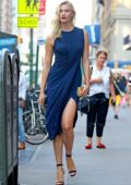 Karlie Kloss steps out wearing a draped blue dress with matching stilettos in New York City