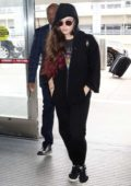 Katherine Langford goes incognito as she arrives to catch a flight out off JFK airport in New York