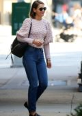 Katie Holmes seen wearing a pink sweater and jeans while out in New York City