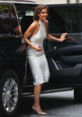 Katie Holmes steps out of her car in a white dress as she heads to a meeting in New York City