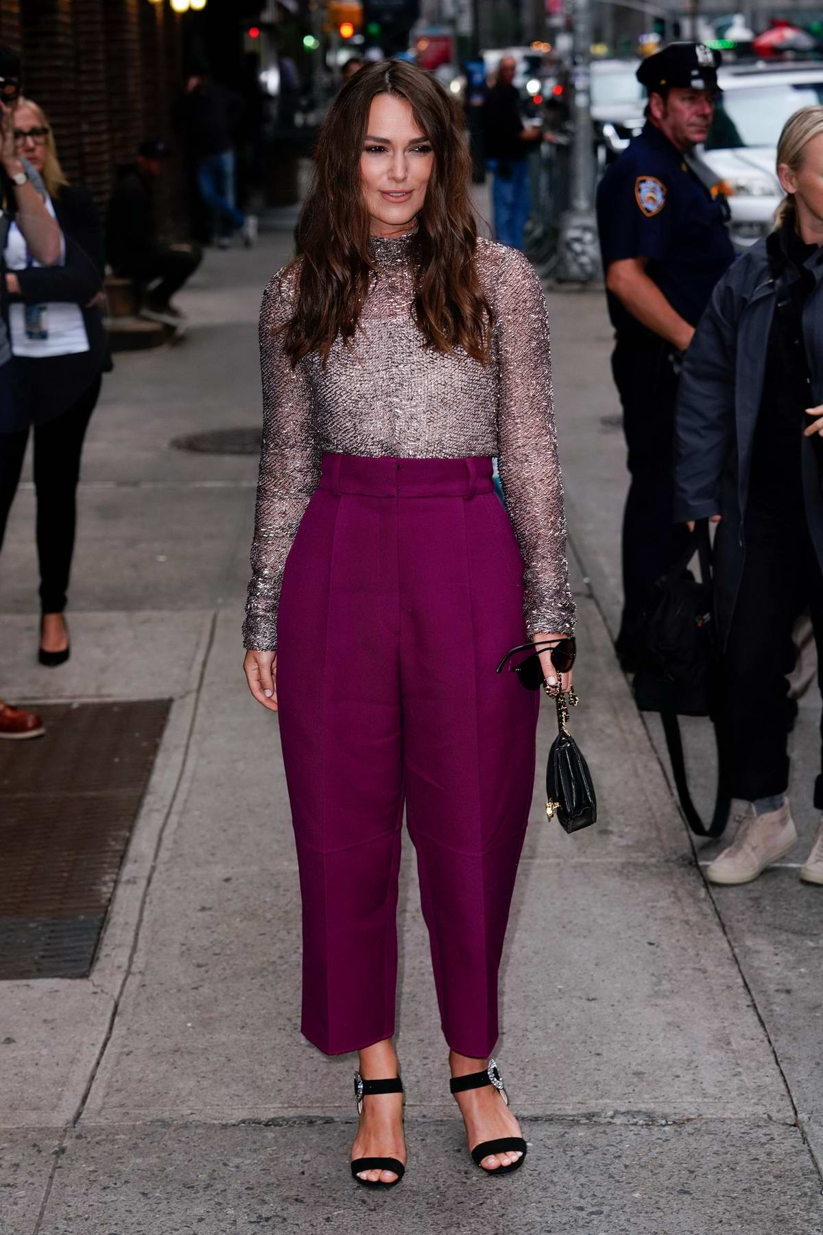 Keira Knightley looks pretty in purple as she arrives at Stephen Colbert Show in New York City