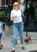 Kelly Rutherford is all smiles as she takes her dogs out for a stroll on a Starbucks coffee run in New York City