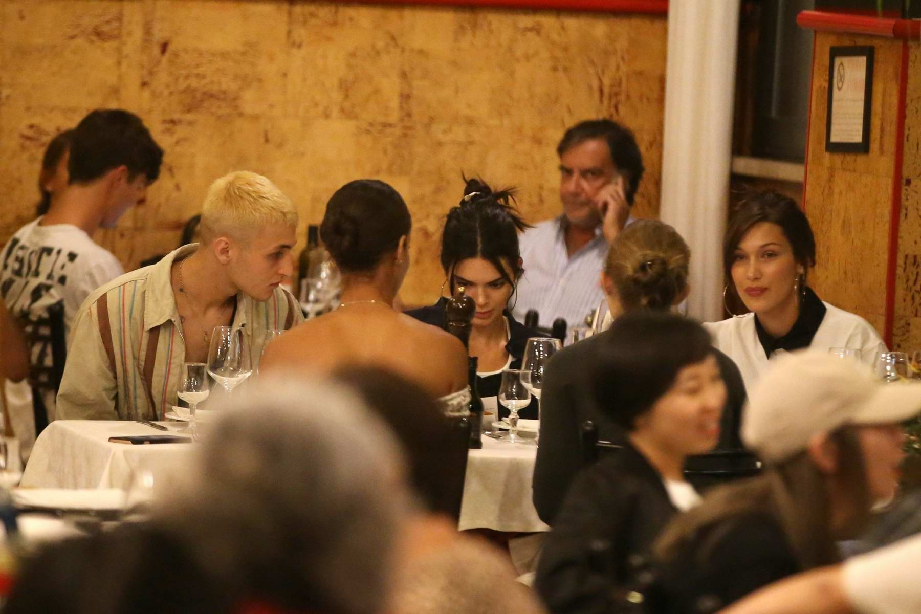 Kendall Jenner, Bella, Gigi and Anwar Hadid seen while having dinner together at a restaurant in Milan, Italy