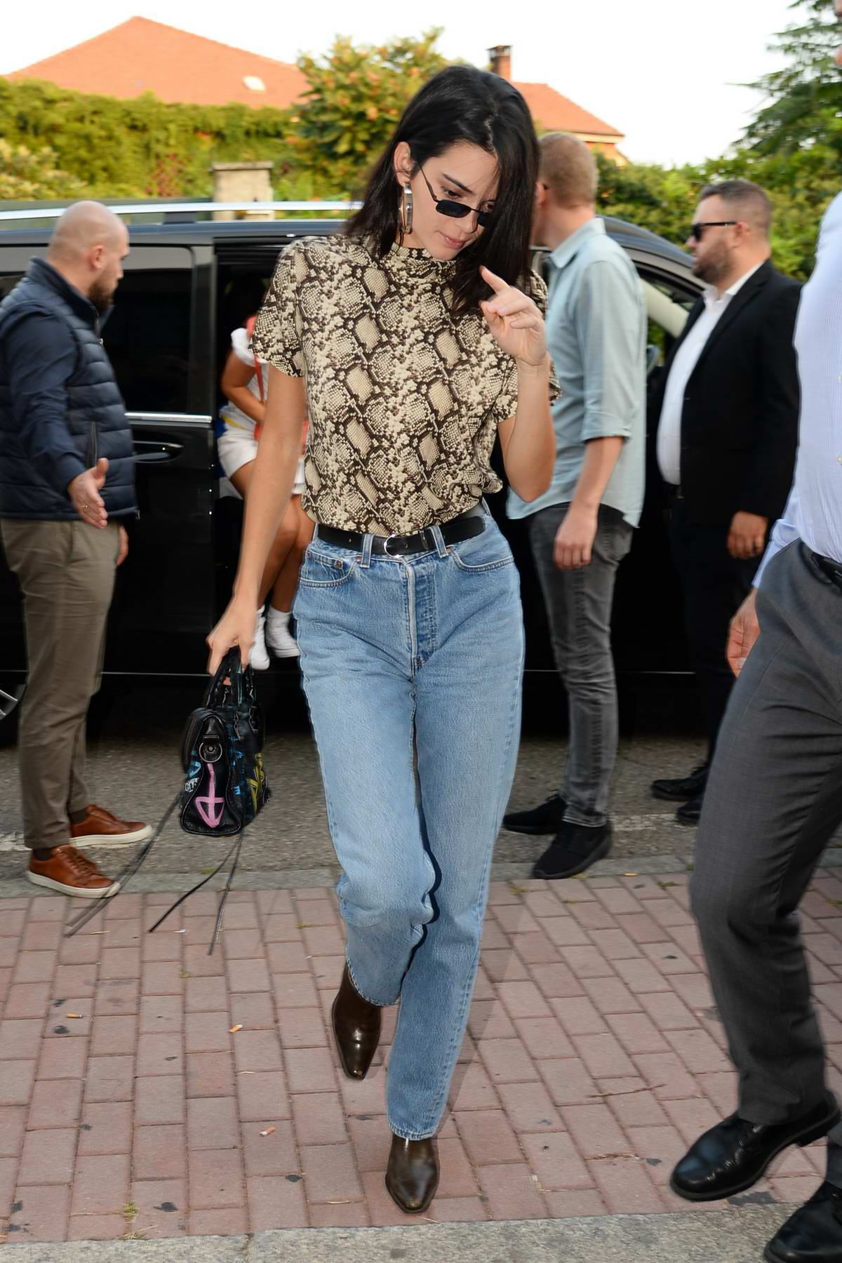 Kendall Jenner rocks a snakeskin print top and jeans while ...
