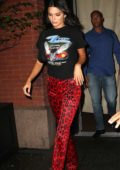 Kendall Jenner wears a graphic tee and red animal print pants as she heads to Cipriani's for a Pre-Fashion Week Party in New York City