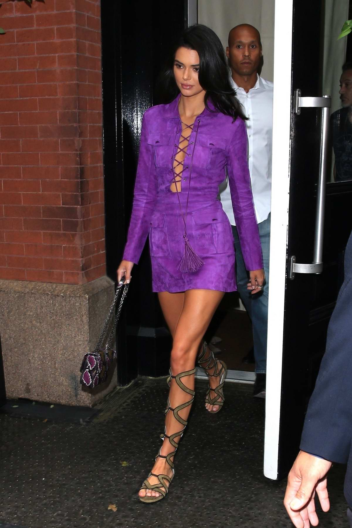 Kendall Jenner wears short purple outfit as she leaves The Mercer Hotel in Soho, New York City