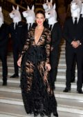 Kendall Jenner wore a black sheer dress at the Longchamp 70th Anniversary Party at Opera Garnier in Paris, France