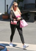 Khloe Kardashian rocks pink and black combo as she leaves a studio in Calabasas, California