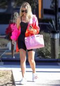 Khloe Kardashian spotted in a colorful jacket over a black outfit as she left Kanye West's office in Los Angeles