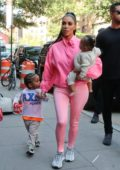 Kim Kardashian spotted out and about with her kids wearing an all pink outfit in New York City