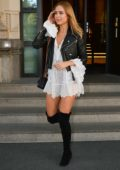 Kimberley Garner steps out in a short white dress with leather jacket and thigh high boots during Milan Fashion Week in Milan, Italy