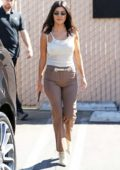 Kourtney Kardashian wears a sheer tank top, brown pinstriped trousers and white snakeskin boots as she grabs lunch with Kris Jenner in Studio City, Los Angeles