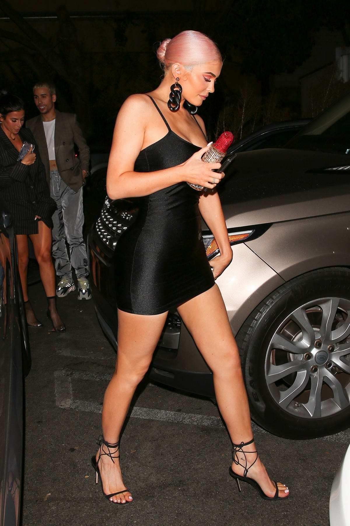 Kylie Jenner Rocks A Short Black Dress As She Arrives At