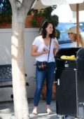 Lana Del Rey spotted in white top and skinny blue jeans while waiting at the valet after lunch at Il Pastaio in Beverly Hills, Los Angeles