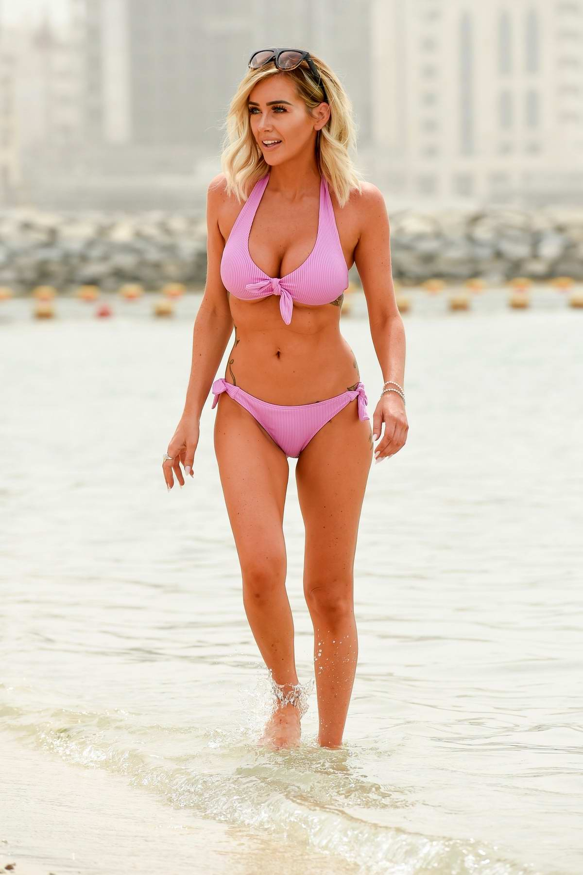 Laura Anderson wears pink bikini as she hits the beach in Dubai, UAE