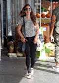 Lily Collins wore a black and white striped tee with black jeans while shopping some groceries at Whole Foods in West Hollywood, Los Angeles