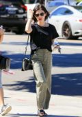Lucy Hale keeps it casual in a black tee and loose olive green cargos while out with a friend in Los Angeles