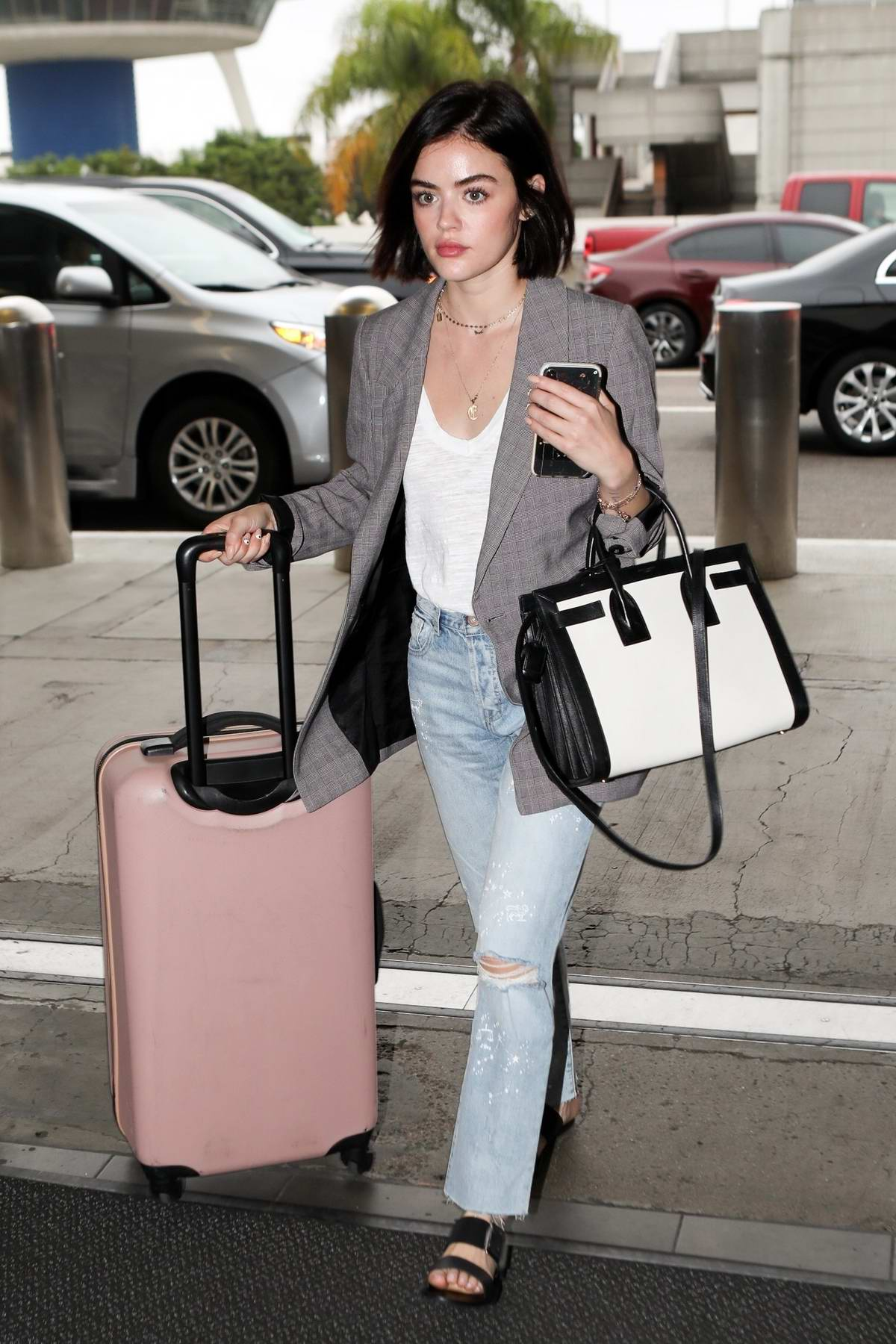 Lucy Hale spotted in a grey blazer and jeans as as she arrives to catch a flight out of LAX in Los Angeles