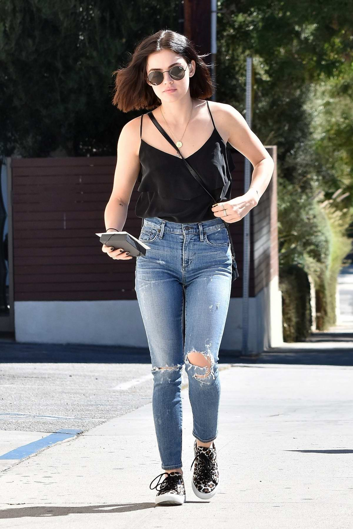 Lucy Hale steps out for lunch in a black top and ripped jeans in Los Angeles